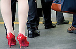 Tokyo, Japan - Red shoes among black ones are shown on the platform at Shinjuku Station. Morning commuters typically spend over one hour on the train going to work. Trains are usually so packed that train platform staff have to push commuters to fit in the train so that the doors can close shut. (Photo by Yumeto Yamazaki/AFLO)