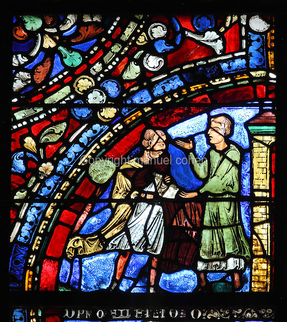 Having returned home, the younger son is dressed by a servant in fine new clothes. The cloak represents baptism or rebirth, the sandals freedom and the ring renewed alliance, from the Parable of the Prodigal Son stained glass window, in the north transept of Chartres Cathedral, Eure-et-Loir, France. This window follows the parable as told by St Luke in his gospel. It is thought to have been donated by courtesans, who feature in 11 of the 30 sections. Chartres cathedral was built 1194-1250 and is a fine example of Gothic architecture. Most of its windows date from 1205-40 although a few earlier 12th century examples are also intact. It was declared a UNESCO World Heritage Site in 1979. Picture by Manuel Cohen