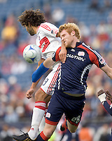 Chicago Fire midfielder Baggio Husidic (9) and New England Revolution midfielder Pat Phelan (28) battle for head ball. The New England Revolution out scored the Chicago Fire, 2-1, in Game 1 of the Eastern Conference Semifinal Series at Gillette Stadium on November 1, 2009.
