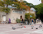 The tools of the street performer's trade begin to accumulate in Duval Square before the evening sunset rush.  Duval Square, Key West, Florida, USA.