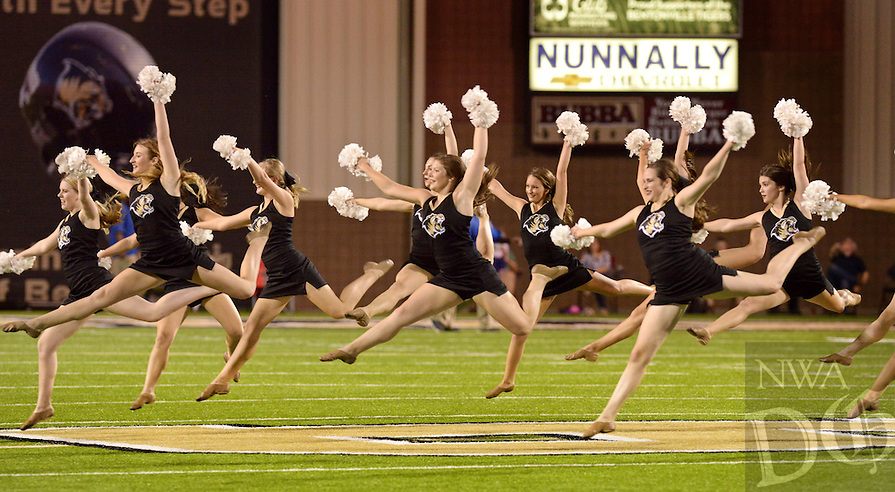 NWA Democrat-Gazette/BEN GOFF @NWABENGOFF<br /> The Bentonville High Golden Tamers dance team perform at halftime on Friday Sept. 18, 2015 during the Bentonville vs Tallahassee (Fla.) Rickards game in Bentonville's Tiger Stadium.