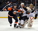 Dec 23, 2008; Uniondale, NY, USA; Atlanta Thrashers defenseman Niclas Havelid (28) and goaltender Johan Hedberg (1) battle for puck with New York Islanders center Josh Bailey (12) during game at the Nassau Coliseum.Thrashers won 4-2. Mandatory Credit: Tomasso DeRosa/SportPics