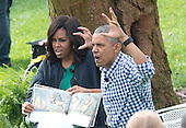"""United States President Barack Obama and first lady Michelle Obama read """"Where the Wild things Are"""" as they host the 2016 White House Easter Egg Roll on the South Lawn of the White House in Washington, DC on Monday, March 28, 2016.<br /> Credit: Ron Sachs / CNP"""