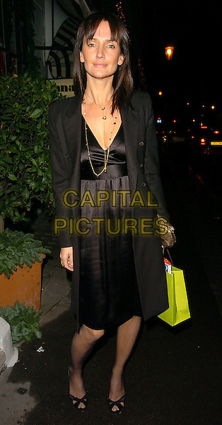 SAFFRON ALDRIDGE.Project Catwalk Reality TV Launch held at San Lorenzo Restaurant, London..UK, United Kingdom..6th December 2005.Ref: CAN.full length black empire line dress silk satin long linen coat holding bag gold clutch handbag.www.capitalpictures.com.sales@capitalpictures.com.©Capital Pictures