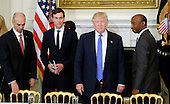 United States President Donald Trump (C) speaks as Juan Luciano (L) Chairman/President/CEO at Archer-Daniels-Midland Co, Jared Kushner, White House Senior Adviser, and Kenneth Frazier Chairman and CEO, Merck  look on during a  listening session with manufacturing CEOs  in the State Dining Room  of the White House on February 23, 2017 in Washington, DC. <br /> Credit: Olivier Douliery / Pool via CNP