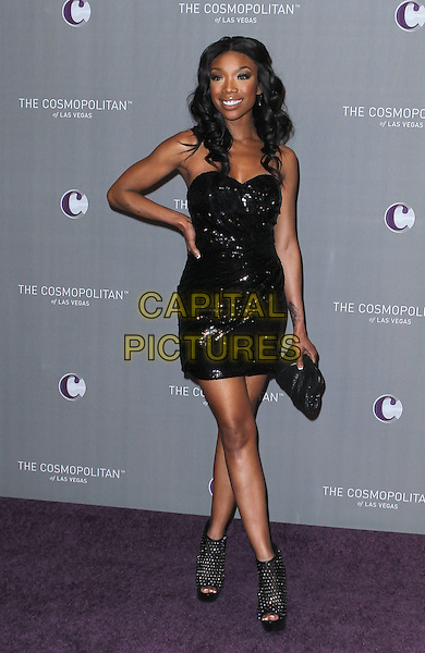 BRANDY NORWOOD .New Year's Eve Grand Opening of the Cosmopolitan of Las Vegas, Las Vegas, Nevada, USA, 31st December 2010..full length strapless black hand on hip dress open toe shoes ankle boots platform clutch bag .CAP/ADM/MJT.© MJT/AdMedia/Capital Pictures.