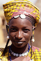 Delaquara, Niger. Young Fulani Woman.  Earrings, Coin Necklace, Headscarf.  Note the tribal identification marks on the cheeks.