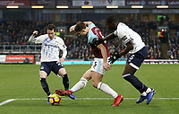 Burnley's James Tarkowski vies for possession with Everton's Bernard (left) and Kurt Zouma<br /> <br /> Photographer Rich Linley/CameraSport<br /> <br /> The Premier League - Burnley v Everton - Wednesday 26th December 2018 - Turf Moor - Burnley<br /> <br /> World Copyright &copy; 2018 CameraSport. All rights reserved. 43 Linden Ave. Countesthorpe. Leicester. England. LE8 5PG - Tel: +44 (0) 116 277 4147 - admin@camerasport.com - www.camerasport.com