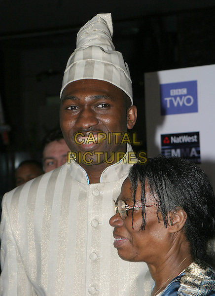 KWAME KWEI-ARMAH.2004 Emma Awards, Grosvenor House Hotel, London.May 24th, 2004.headshot, portrait, hat, stripes.www.capitalpictures.com.sales@capitalpictures.com.© Capital Pictures.