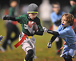 The Panthers' Jack Dye vs. The Eagles' Philip Neilson in Oxford Park Commission flag football, at FNC Park in Oxford, Miss. on Tuesday, November 19, 2013.