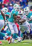 14 September 2014: Miami Dolphins running back Damien Williams rushes for a 3 yard gain against the Buffalo Bills in the second quarter at Ralph Wilson Stadium in Orchard Park, NY. The Bills defeated the Dolphins 29-10 to win their home opener and start the season with a 2-0 record. Mandatory Credit: Ed Wolfstein Photo *** RAW (NEF) Image File Available ***