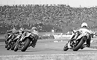 A pack of motorcycles races trough a turn during the daytona 200, Daytona INternational Speedway, Daytona beach, FL, March 1986.  (Photo by Brian Cleary/www.bcpix.com)