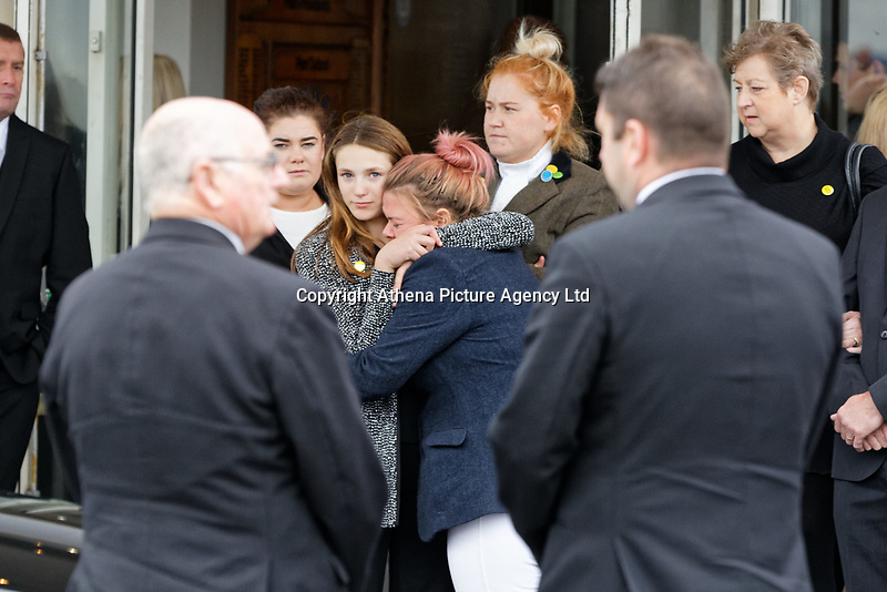 "Pictured: Danielle John (C), the sister of Bradley at Aberavon Beach Hotel in Port Talbot, Wales, UK. Monday 08 October 218<br /> Re: A grieving father will mourners on horseback at the funeral of his ""wonderful"" son who killed himself after being bullied at school.<br /> Talented young horse rider Bradley John, 14, was found hanged in the school toilets by his younger sister Danielle.<br /> Their father, farmer Byron John, 53, asked the local riding community to wear their smart hunting gear at Bradley's funeral.<br /> Police are investigating Bradley's death at the 500-pupils St John Lloyd Roman Catholic school in Llanelli, South Wales.<br /> Bradley's family claim he had been bullied for two years after being diagnosed with Attention Deficit Hyperactivity Disorder.<br /> He went missing during lessons and was found in the toilet cubicle by his sister Danielle, 12."