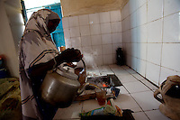 Safia Ali, 18 years old, pours tea in the kitchen of a hotel where she works in Baidoa, Somalia on Friday january 05 2007..Only a few days after the fall of the United Islamic Courts in Mogadishu, Ethiopian and Transitional Federal Government troops are patrolling the city and securing strategic locations..The people in Mogadishu appear confused and doubtful on thei