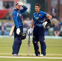 Alex Blake (L) and Joe Denly discuss tactics during the Royal London One Day Cup game between Kent and Glamorgan at the St Lawrence Ground, Canterbury, on May 25, 2018