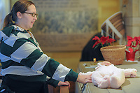 Michelle Schumacher of Langhorne, Pennsylvania places her daughter Molly Kathleen on the tomb of St. Katharine Drexel at the National Shrine of St. Katharine Drexel Thursday, December 28, 2017 in Bensalem, Pennsylvania. Drexel was an American heiress who dedicating herself to work among the American Indians and African-Americans in the western and southwestern United States. She was canonized a saint by the Roman Catholic Church in 2000. (Photo by William Thomas Cain/Cain Images)