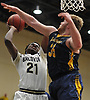 Marcus Jasmin #21 of Baldwin, left, tries to get to the net as Connor Payne #35 of Massapequa contests his shot during the Nassau County varsity boys basketball Class AA semifinals at Farmingdale State College on Monday, Feb. 26, 2018. Baldwin won by a score of 50-41.