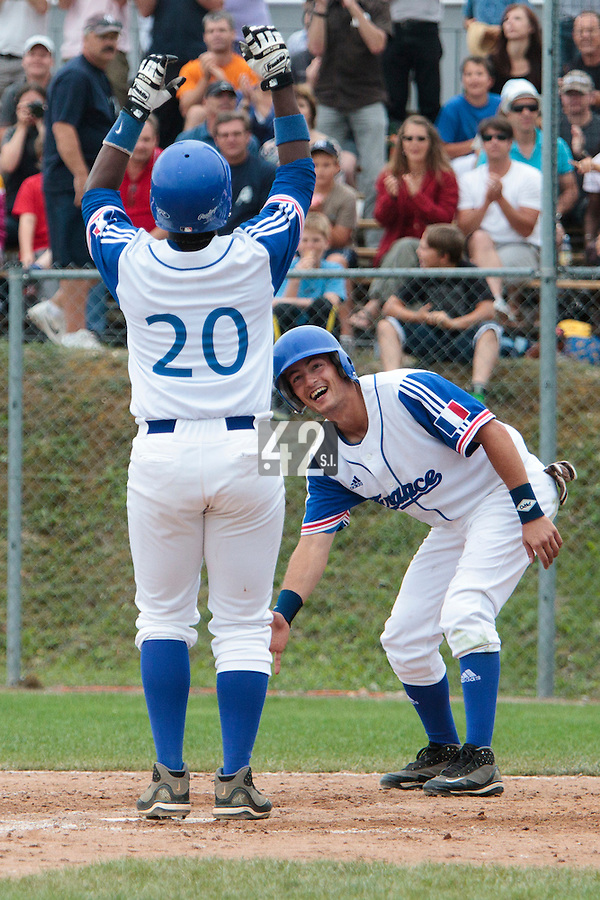 25 july 2010: Omar Williams of Team France is welcomed by Romain Scott Martinez as he scores on a home run during France 6-1 victory over Czech Republic, in day 3 of the 2010 European Championship Seniors, in Neuenburg, Germany.