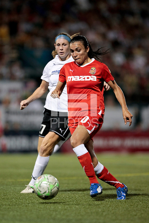 Marta (10) of the Western New York Flash and Nikki Marshall (27) of the magicJack battle for control. The Western New York Flash defeated the magicJack 3-1 in Women's Professional Soccer (WPS) at Sahlen's Stadium in Rochester, NY July 20, 2011.