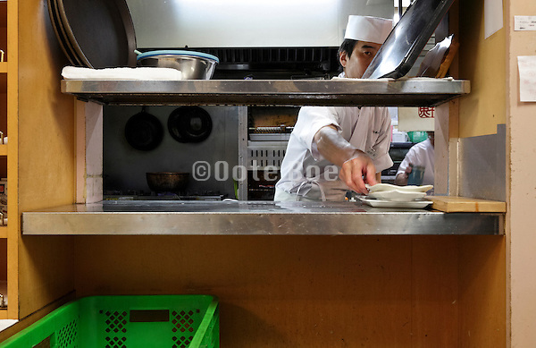 dishes cleaning counter inside sushi restaurant at Tsukiji fish market Tokyo, Japan.