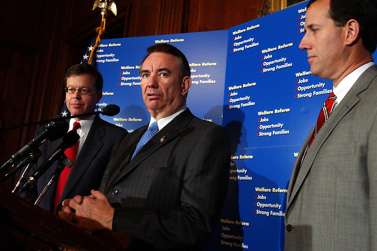 Secretary of Health and Human Services, Tommy Thompson, speaks at a press conference with Sens. Rick Santorum, R-Pa., right, and Jim Talent, R-Mo., on a welfare reform plan that encourages work and healthy marriages.