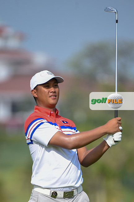 Chanpasit OUNAPHOM (LAO) hits his approach shot on 3 during Rd 1 of the Asia-Pacific Amateur Championship, Sentosa Golf Club, Singapore. 10/4/2018.<br /> Picture: Golffile | Ken Murray<br /> <br /> <br /> All photo usage must carry mandatory copyright credit (© Golffile | Ken Murray)