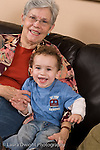 2 year old toddler boy at home portrait with grandmother vertical Caucasian