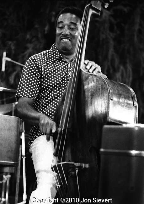 Ray Brown, July 1975, Concord Summer Festival, 16-23-28. Quintessential Jazz Bassist.  He took part in a number of early bop recording sessions with Charlie Parker, Dizzy Gillespie, Bud Powell, and others, and played in Gillespie's big band (1946-47), &quot;Two Bass Hit&quot; [mp3]. Thereafter he toured for several years as the music director for Ella Fitzgerald, who was at that time his wife.<br />