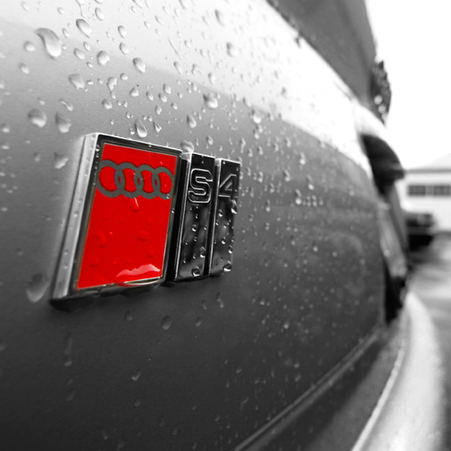 Audi S4 rear badge with rain droplets.