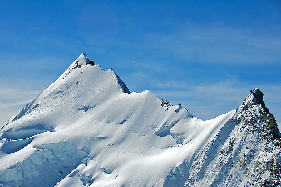 Razor sharp summit ridge on the Weisshorn mountain in the Swiss Alps