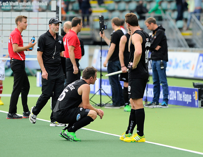 The Hague, Netherlands, June 08: Shea McAleese #25 and Alex Shaw #19 of New Zealand disappointed on the field after the field hockey group match (Men - Group B) between the Black Sticks of New Zealand and Germany on June 8, 2014 during the World Cup 2014 at Kyocera Stadium in The Hague, Netherlands.  Final score 3-5 (1-3) (Photo by Dirk Markgraf / www.265-images.com) *** Local caption ***