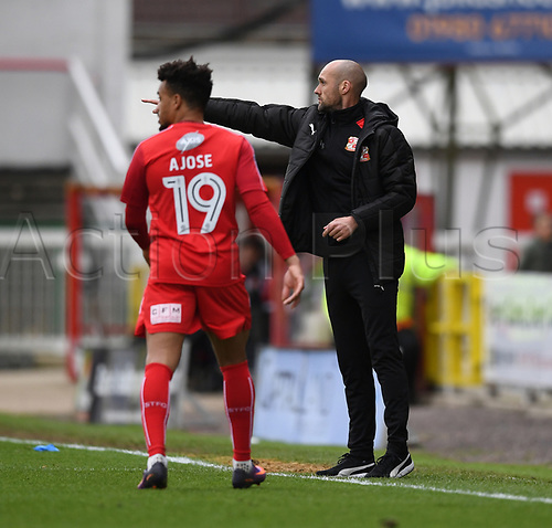 April 14th 2017, County Ground, Swindon, Wiltshire; Skybet league 1 football, Swindon Town versus AFC Wimbledon; Nicky Ajose of Swindon Town receives instruction from Luke Williams, head coach for Swindon Town
