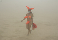 BLACK ROCK CITY,NV - AUGUST 30, 2008: On Saturday a dust storm created a 'white out', at  Burning Man event, August 30, 2008. That didn't stop participants from costume play.