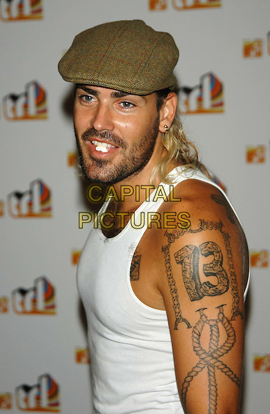 SHANE LYNCH.MTV TLR launch party.TLR UK launch date: 19 August 2003.sales@capitalpictures.com.www.capitalpictures.com.©Capital Pictures.tattoo, flat cap.half length, half-length, chewing gum, look closer