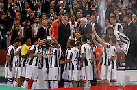 Calcio, finale Tim Cup: Milan vs Juventus. Roma, stadio Olimpico, 21 maggio 2016.<br /> Italian President Sergio Mattarella gives the trophy to Juventus&rsquo; Giorgio Chiellini at the end of the Italian Cup final football match between AC Milan and Juventus at Rome's Olympic stadium, 21 May 2016. Juventus won 1-0 in the extra time.<br /> UPDATE IMAGES PRESS/Isabella Bonotto