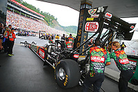 Jun 19, 2015; Bristol, TN, USA; Crew members push NHRA top fuel driver Terry McMillen forward during qualifying for the Thunder Valley Nationals at Bristol Dragway. Mandatory Credit: Mark J. Rebilas-