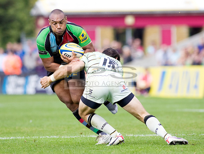 Harlequins and england centre Jordan Turner-Hall is tackled by Northampton Saints James Ben Fodden, 11/09/2010. Picture by Mark Greenwood  - Copyright:  IPS Photo Agency: 21 Delisle Road  London SE28 0JD - Personal mobile: 07710614642.