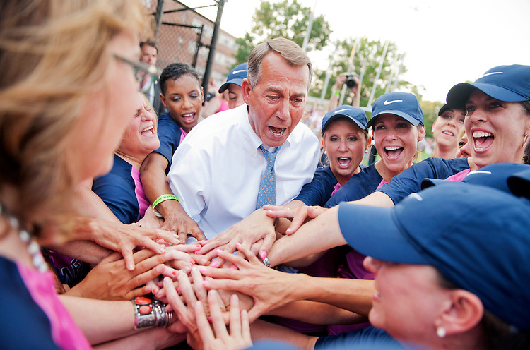 UNITED STATES - JUNE 18: Speaker John Boehner, R-Ohio, huddles with the team before the Congressional Women's Softball game that pits Congresswomen against female journalists at Watkins Recreation Center on Capitol Hill, June 18, 2014. Team Congress prevailed in a 10-5 victory. The game benefits the Young Survival Coalition that helps young women with breast cancer. (Photo By Tom Williams/CQ Roll Call)