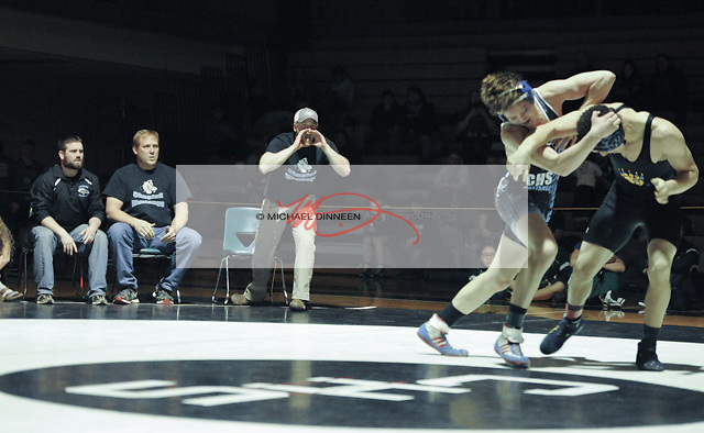 Chugiak wrestler Joey Lerch recieves encouragement from his coaching staff  as his 182 lb. final with Bartlett's Elijah Lear winds down.  Lerch lost his match 5-4.  Photo for the Star by Michael Dinneen.