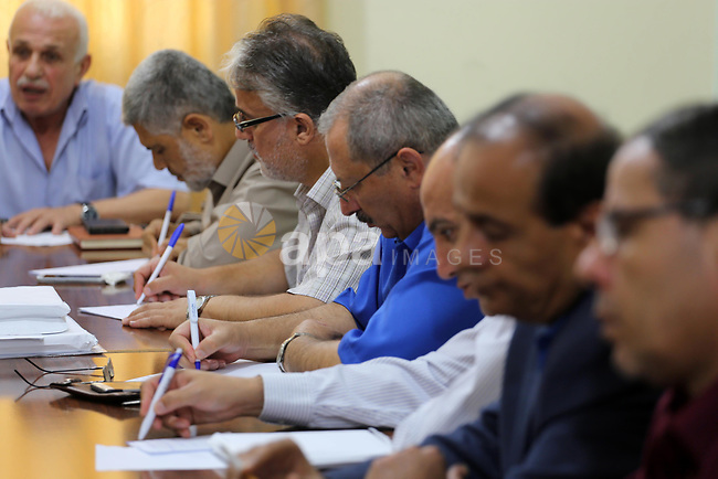 """Leaders of Palestinian factions, attend a meeting in Gaza city on Sept. 17, 2017. Hamas announced it had agreed to steps toward resolving a decade-long split with the Fatah movement and was ready to hold elections. Hamas said it had agreed to key demands made by Fatah: dissolving the so-called """"administrative committee"""", while saying it was ready for elections and negotiations toward a unity government.Photo by Mohammed Asad"""
