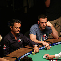 JOE HACHEM & BEN AFFLECK.The Ante Up for Africa Celebrity Poker Tournament at the Rio Resort Hotel and Casino, Las Vegas, Nevada, USA..July 2nd, 2009.half length table bet betting chips cards black blue t-shirt head in hand .CAP/ADM/MJT.© MJT/AdMedia/Capital Pictures