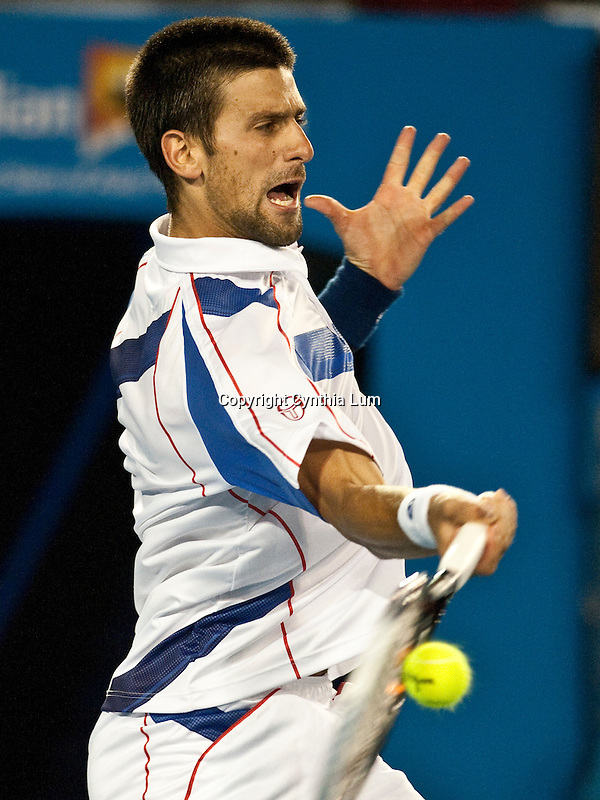 January 25, 2011.Novak Djokovic of Serbia in action, defeating Tomas Berdych of Czech Republich in the quarter final of  the Australian Open,Rod Laver Stadium, Melbourne Park, Melbourne, Australia.