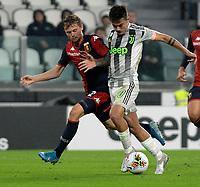 30th October 2019; Allianz Stadium, Turin, Italy; Serie A Football, Juventus versus Genoa; Peter Ankersen of Genoa FC challenges Paulo Dybala of Juventus - Editorial Use