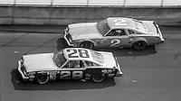 Buddy Baker, #28 Oldsmobile, Dale Earnhardt, #2 Oldsmobile, 1979 Firecracker 400 NASCAR race, Daytona International Speedway, Daytona Beach, FL, July 4, 1979.  (Photo by Brian Cleary/ www.bcpix.com )