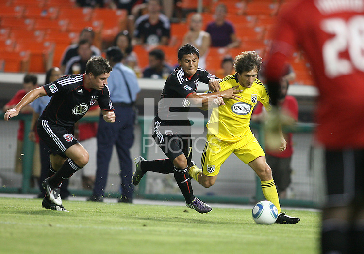 Devon McTavish #18 and Andy Najar #14 of D.C. United go after Guillermo Barros Schelotto #7 of the Columbus Crew during a US Open Cup semi final match at RFK Stadium on September 1 2010, in Washington DC. Columbus won 2-1 aet.