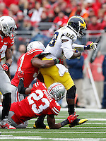 Ohio State Buckeyes safety Tyvis Powell (23) and Ohio State Buckeyes linebacker Joshua Perry (37) tackle Michigan Wolverines quarterback Devin Gardner (98) during the 2nd quarter of the NCAA football game at Ohio Stadium on Nov. 29, 2014. (Adam Cairns / The Columbus Dispatch)