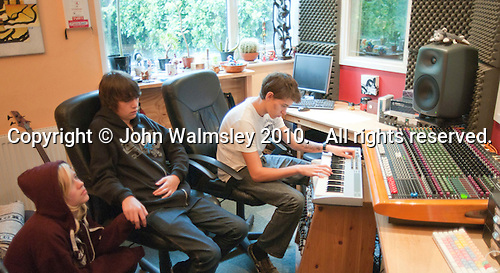 Waiting for rehearsals to begin, music studio, Summerhill School, Leiston, Suffolk. The school was founded by A.S.Neill in 1921 and is run on democratic lines with each person, adult or child, having an equal say.  You don't have to go to lessons if you don't want to but could play all day.  It gets above average GCSE exam results.