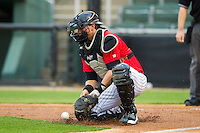 Kannapolis Intimidators catcher Michael Marjama (12) blocks a throw to home plate during the South Atlantic League game against the Delmarva Shorebirds at CMC-Northeast Stadium on April 15, 2013 in Kannapolis, North Carolina.  The Shorebirds defeated the Intimidators 8-4.  (Brian Westerholt/Four Seam Images)