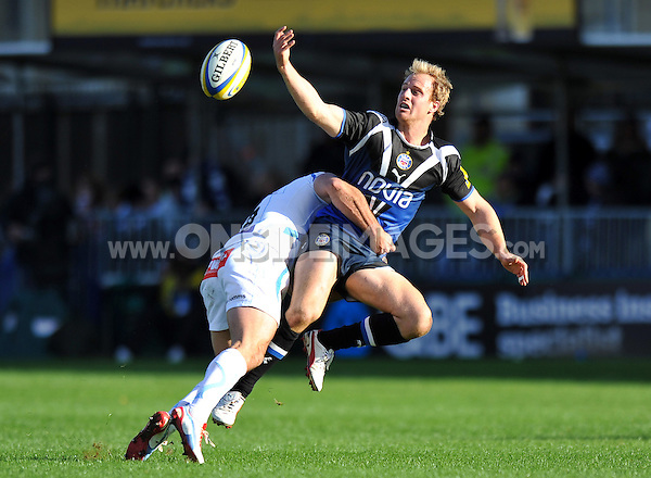 Nick Abendanon offloads the ball after being tackled. Aviva Premiership match, between Bath Rugby and Exeter Chiefs on October 27, 2012 at the Recreation Ground in Bath, England. Photo by: Patrick Khachfe / Onside Images