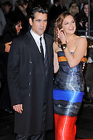 Colin Farrell and Ruth Wilson<br /> attending the 57th BFI London Film Festival Closing Night Gala World Premiere of 'Saving Mr Banks', Odeon Cinema, Leicester Square, London, England. <br /> 20th October 2013<br /> half length black orange blue grey gray  strapless stripe dress cuff bracelet coat suit <br /> CAP/MAR<br /> © Martin Harris/Capital Pictures